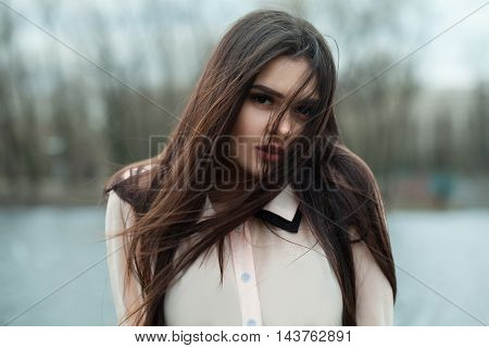 Beautiful Girl Model in a Blouse Outdoor