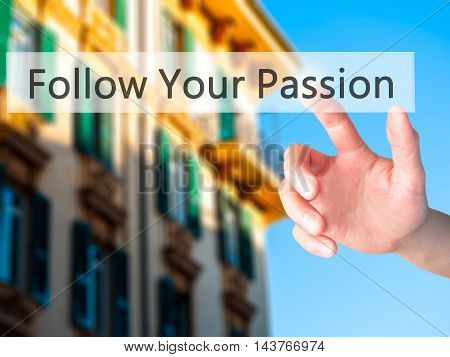 Follow Your Passion - Hand Pressing A Button On Blurred Background Concept On Visual Screen.