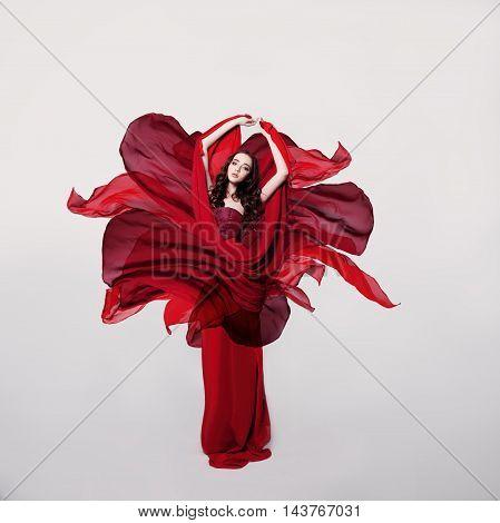 Woman Fashion Model in Red Flower Silk Dress