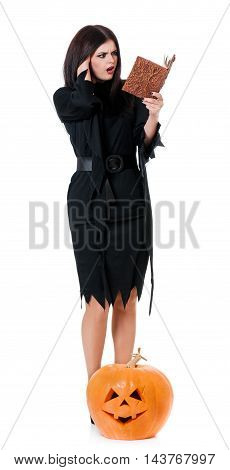 Shocked witch with book for spells isolated on a white background