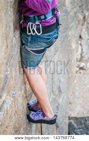 Rock climber preparing for climbing feet close-up poster