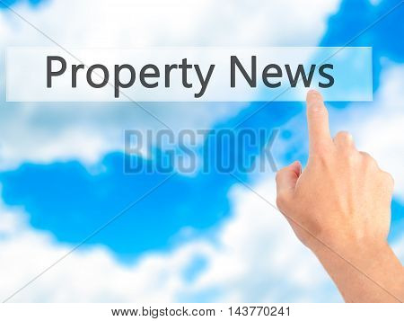 Property News - Hand Pressing A Button On Blurred Background Concept On Visual Screen.