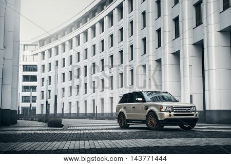 Moscow, Russia - November 22, 2015: Car Land Rover Range Rover Stand Near Modern Building In Moscow