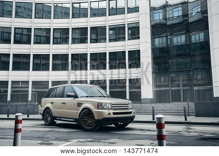 Moscow, Russia - November 22, 2015: Car Land Rover Range Rover stand near modern building in Moscow city at daytime