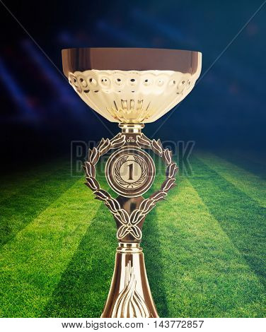 Trophy cup on football field