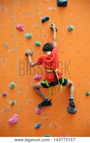 Rave Teenage With Harness Climbing Vertical Wall