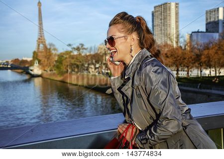 Woman Looking Into Distance And Speaking On Cell Phone, Paris