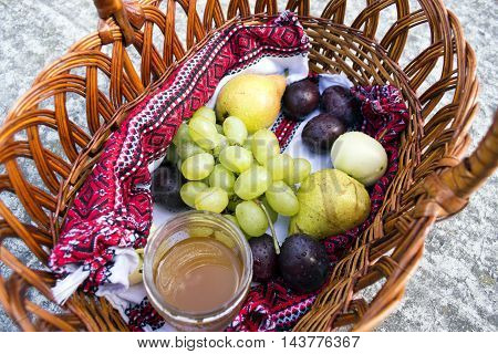 Basket with sanctified apples plums pears and grapes on the feast of the Transfiguration