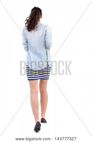back view of running  woman. beautiful girl in motion. backside view of person.  Rear view people collection. Isolated over white background. Swarthy girl in a checkered dress runs deep into the frame