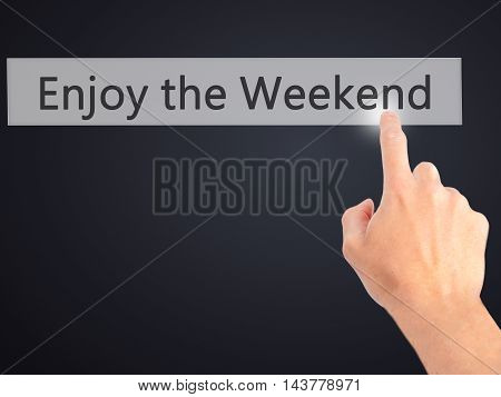 Enjoy The Weekend - Hand Pressing A Button On Blurred Background Concept On Visual Screen.