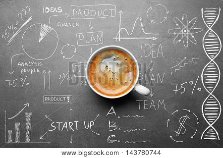 Cup of tasty coffee on gray background. Sketch of business plan.