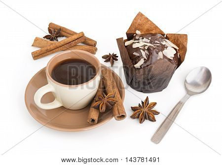 Coffee cup and chocolate cupcake on white background