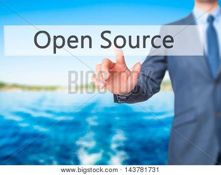 Open Source -  Businessman Press On Digital Screen.