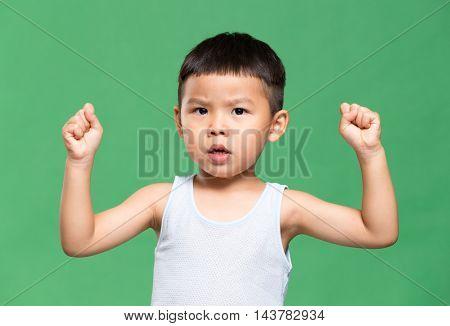 Little boy making a stronger pose