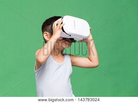 Asian little boy watching VR