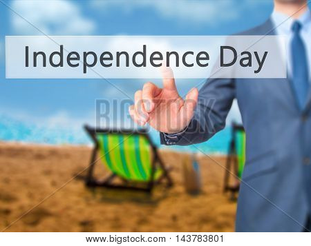 Independence Day -  Businessman Press On Digital Screen.