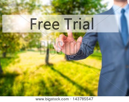 Free Trial -  Businessman Press On Digital Screen.