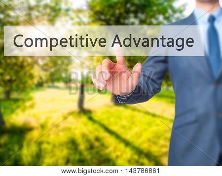 Competitive Advantage -  Businessman Press On Digital Screen.