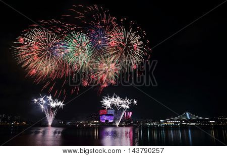 Fireworks celebrating Singapore national day across the Kallang River