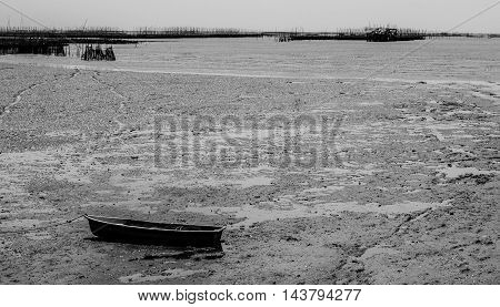 the small boat land on mud when the neap tide in evening