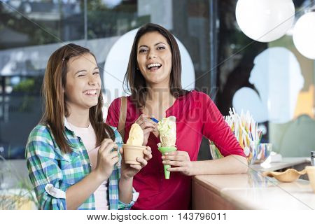 Happy Mother And Daughter With Vanilla Ice Creams