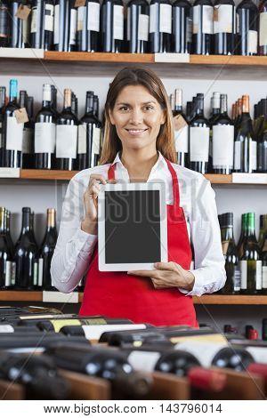 Saleswoman Showing Blank Digital Tablet In Wine Shop