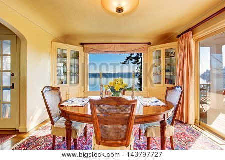 Dining Room Interior With Wooden Table Set. Amazing Water View.