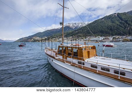 QUEENSTOWN NEW ZEALAND - SEPTEMBER 6: sailing yacht boat floating in lake wakatipu queenstown important traveling destination of south island on september 6 2015 in Queenstown New Zealand