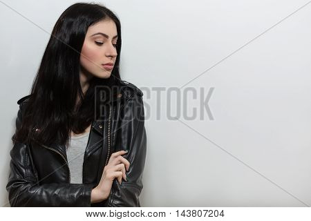 Portrait of Beautiful brunnette model woman posing with her arms crossed or folded isolated on white background in studio.