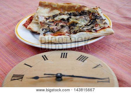 concept of time of pizza express with slices of pizza and a clock