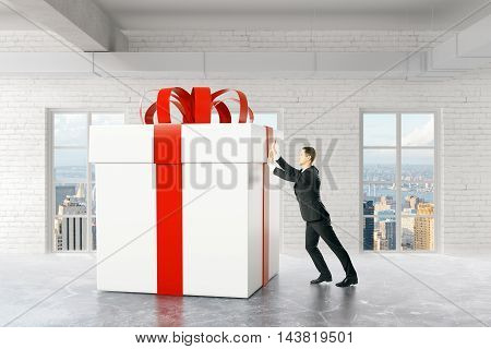 Businessman pushing huge present box in brick interior with city view. 3D Rendering