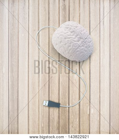 Brainstorming concept with abstract human brain usb plug on light wooden surface. 3D Rendering