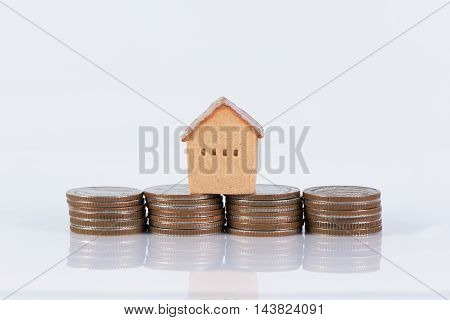 House and coins stack realestate concept on white background