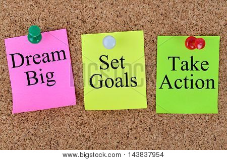 Dream big Set goals Take action written on colorful notes