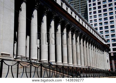 New York City - July 4 2009: The imposing United States Post Office at Eighth Avenue and West 32nd Street with its classical east front lined with massive Corinthian columns