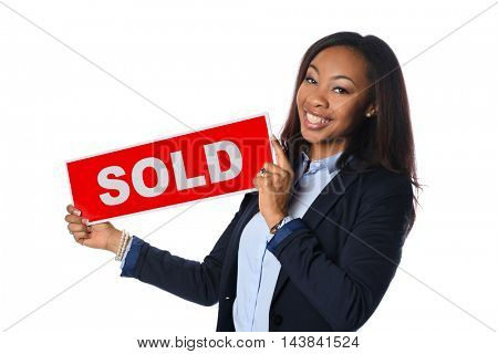 Portrait of African American businesswoman holding sold sign isolated over white background