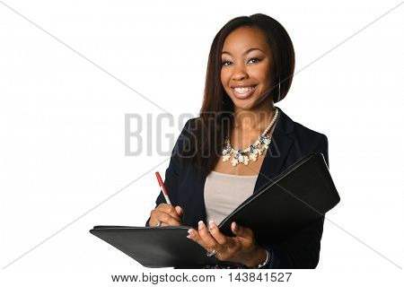 Beautiful African American businesswoman with binder and pen isolated over white background