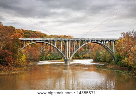 Roadway Bridge On An Overcast Autumn Morning Over The Little Miami River Ohio USA