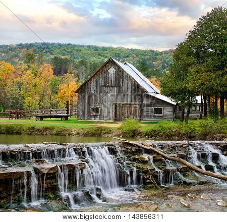 A Pastoral Scene Old Barn And Waterfall During Autumn In New England USA
