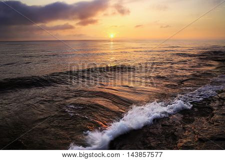 The First Light Of Dawn As Sunrise Breaks Over Lake Erie At Marblehead Ohio USA