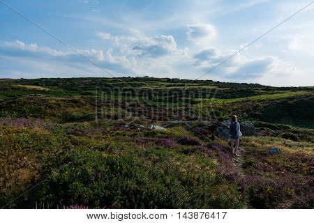 Young Girl Backpacking on Hilltop Howth Harbor Landscape Daytime Ireland