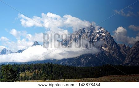 The Grand Tetons mountains with the clouds