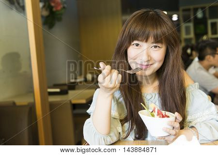 Young Smiling Girl Eating Salad At Luch Break