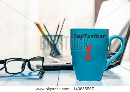 September 1st. Day 1 of month, Back to school concept. Calendar on teacher or student workplace background. Autumn time. Empty space for text.