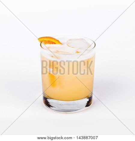 Glass of Whiskey sour with orange in white background