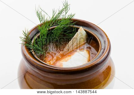 Meat solyanka with cumin herbs in chinese stew on white background