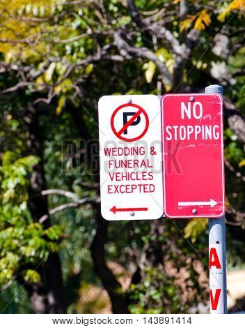 No Parking sign exempt for wedding and funeral service vehicles
