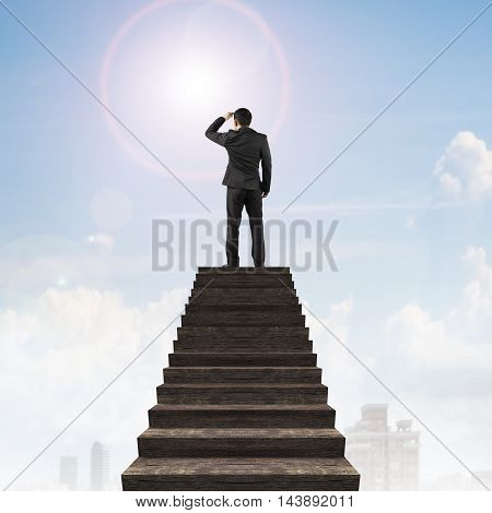 Businessman Gazing On Top Of Wooden Stairs