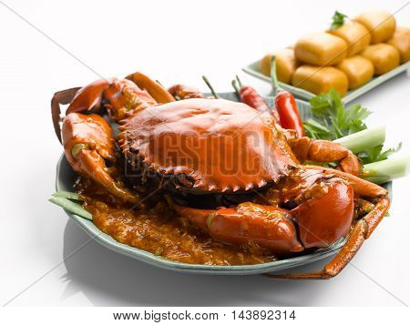 Special fried crab with chili sauce and fried dumplings on white background