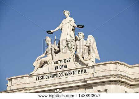 Detail of the Rua Augusta Arch depicting Victory rewarding Valor and Genius in Lisbon Portugal Translation: